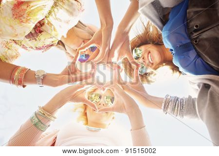 A picture of group of happy friends showing hearts