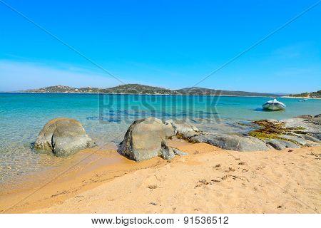 Rubber Boat And Rocks In Porto Pollo Beach