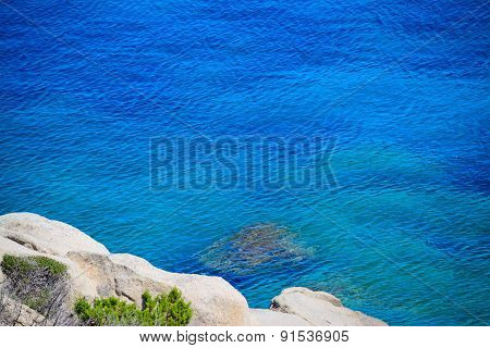 White Rocks And Blue Sea In Capo Testa