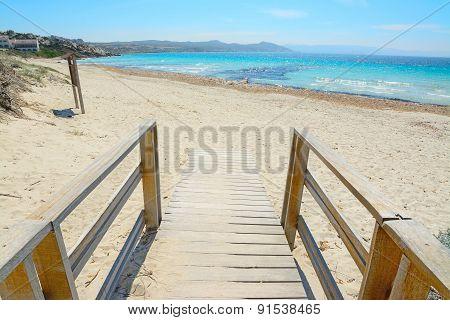 Wooden Boardwalk To The Beach In Capo Testa