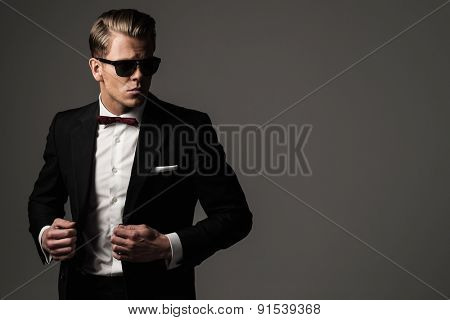 Tough sharp dressed man in black suit
