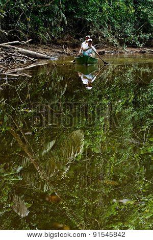Canoeing in amazon rainforest, Yasuni National Park, Ecuador