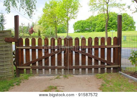The Closed Brown Wooden Gate