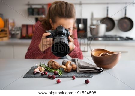 Woman Food Photographer Taking Closeup Of Mushrooms