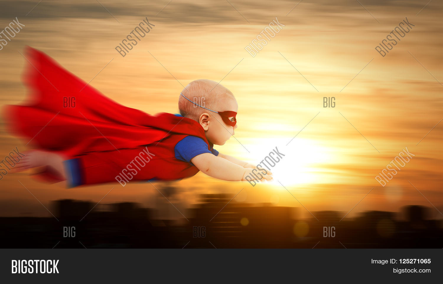 Toddler little baby superman image photo bigstock toddler little baby superman superhero with a red cape flying through sunset sky above the city publicscrutiny Images