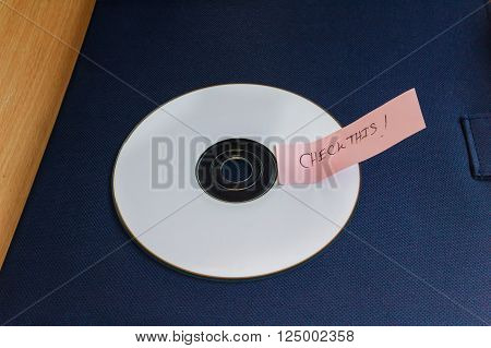 Cd Or Compact Disk With Note Text Word Check This On Table With Copy Space
