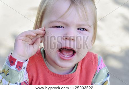Little girl crying and offended. The vagaries of the baby