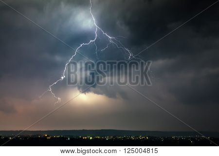 Lightnings over city during thunderstorm in the night