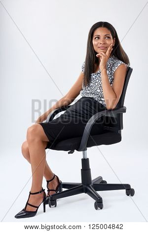 young business executive sits on office chair and ponders her career options