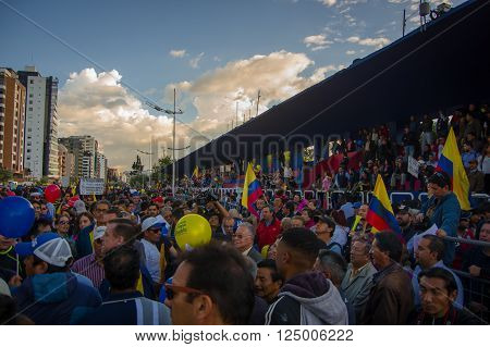 Quito, Ecuador - April 7, 2016: Group of people, police and journalists during anti government protests in Shyris Avenue.