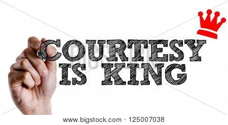 Hand writing the text: Courtesy Is King