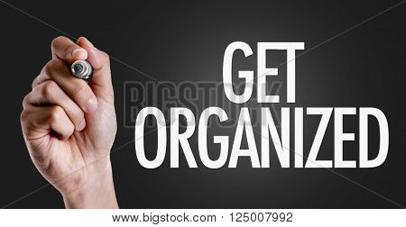 Hand writing the text: Get Organized