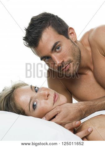 a man and a woman foreplaying in a white background