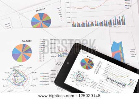 Business performance analysis. Business Graphs with tablet.