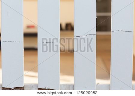 white wood fence of broken damaged, construction industry
