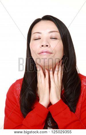 Japanese woman doing a self lymph node massage?