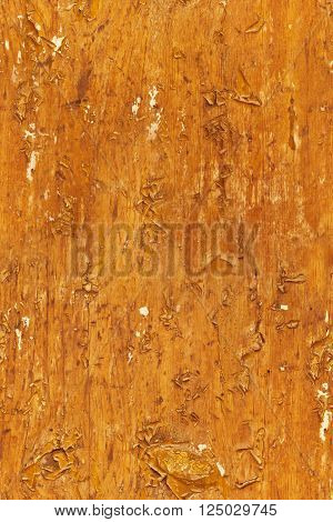 A seamless background texture of crackled yellow wooden boards