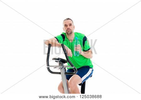Young Manwith Water Bottle Train With Fitness Machine