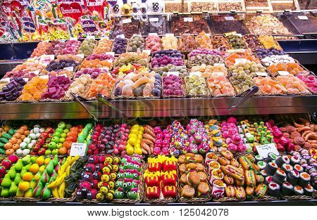 SPAIN, BARCELONA, JUNE, 29, 2015 - La Boqueria market with sweets, candies and dried fruits in Barcelona, Spain. La Boqueria market, Europe's largest and most famous food markets.