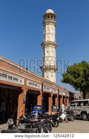 JAIPUR INDIA - 23RD MARCH 2016: Low angle view of the Ishwar Lat or Swarg Suli Tower in central Jaipur during the day. Walking to the top offers high views of the city.