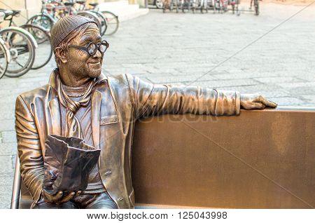 Bologna Italy March 19 2016: statue in honor of the famous Italian singer Lucio Dalla in Piazza Celestine