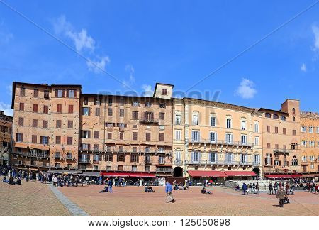 SIENA, ITALY - MARCH 12, 2016: Campo Square with Public Building, Siena, Italy