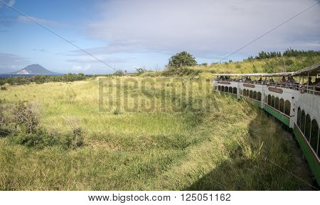 SAINT KITTS, CARIBBEAN, 29 DECEMBER 2015 - The scenic railway on the island of St Kitts with the island of Nevis in the distance