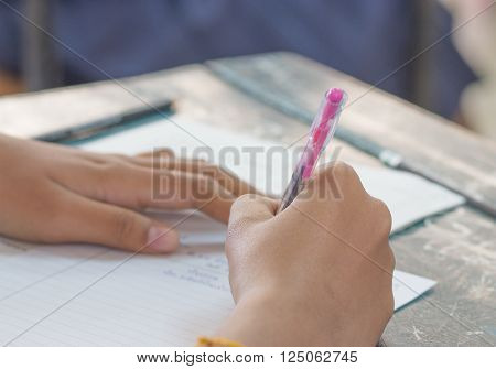 Thai student writing a test in exercise Exams selective focus