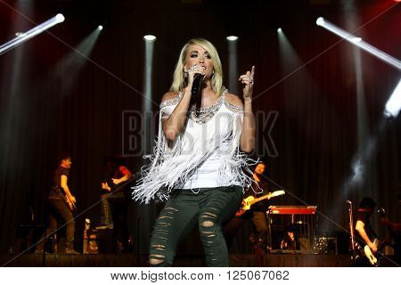 Singer Carrie Underwood performs onstage at the 4th ACM Party for a Cause Festival at the Las Vegas Festival Grounds on April 1, 2016 in Las Vegas, Nevada.