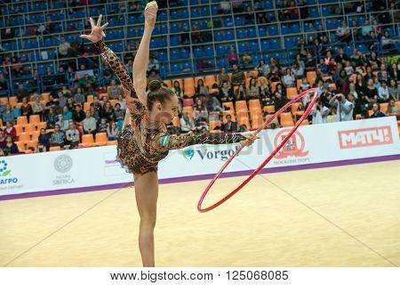 MOSCOW RUSSIA - FEBRUARY 19 2016: Serdyukova Anastasiya Uzbekistan on Rhythmic gymnastics Alina Cup Grand Prix Moscow - 2016 in Moscow sport palace Luzhniki Russia