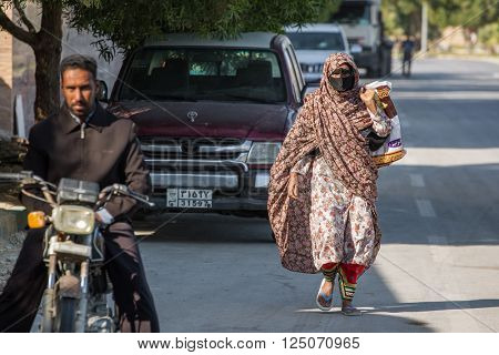 Qeshm, Iran - December 20, 2015: Bandari woman wearing a traditional mask called the burqa, Qeshm Island, Iran
