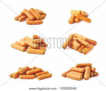 Pile of orange glaze licorice stick candy isolated over the white background, set of six different foreshortenings
