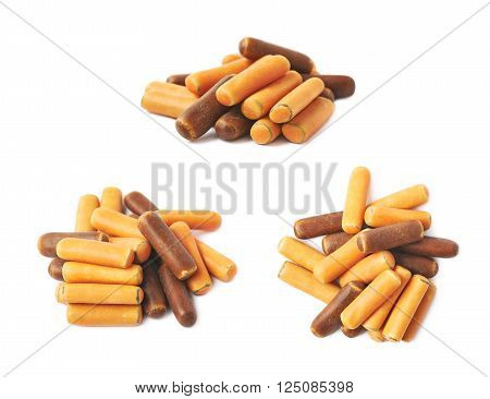 Pile of licorice stick candies isolated over the white background, set of three different foreshortenings