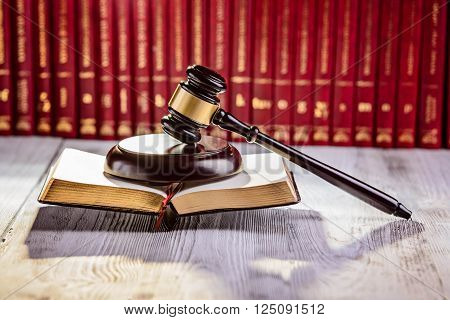 Gavel the symbol of law in court library with legal codes. Law concept