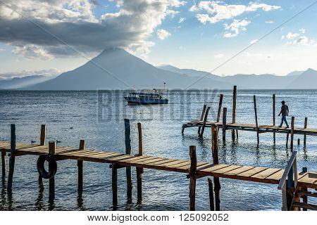 Evening light on Lake Atitlan with San Pedro volcano behind in Guatemalan highlands