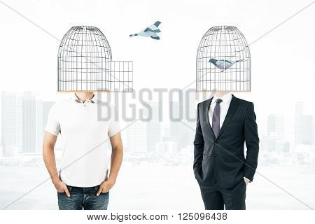 Businessperson and casual man with birdcages instead of heads