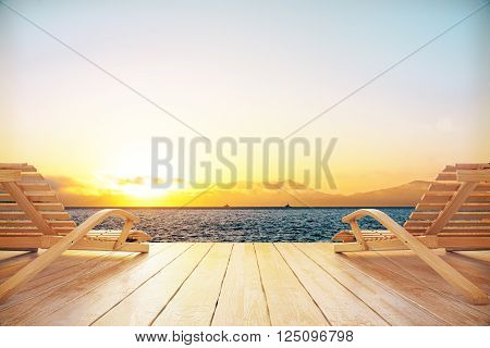 Sunset And Chaise Longues
