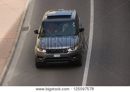 Monte-Carlo, Monaco - April 6, 2016: Aerial view of a Land Rover Range Rover Sport SUV in the Streets of Monaco. Man Driving a Black Range Rover Sport in the South of France