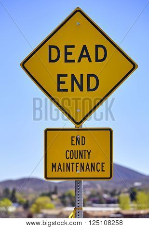 street sign dead end no county maintenance blue sky