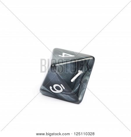 Roleplaying black polyhedral octahedron gaming plastic dice isolated over the white background