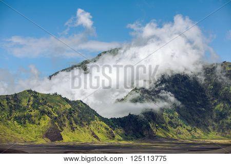 Clouds on the ridge of Mount Bromo volcano caldera, Java, Indonesia