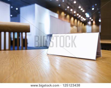 Mock up Blank sign on desk Event Hall Background