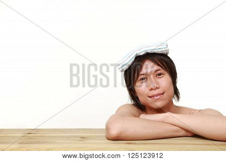 portrait of young man relaxing Japanese traditiona bath