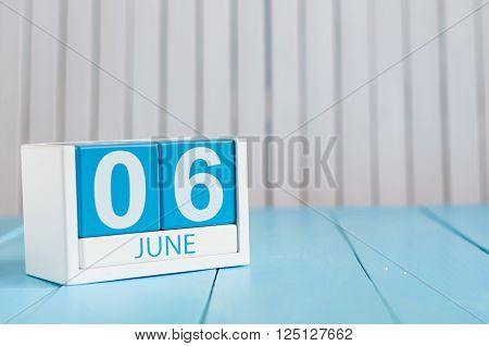 June 6th. Image of june 6 wooden color calendar on white background. Summer day, empty space for text.