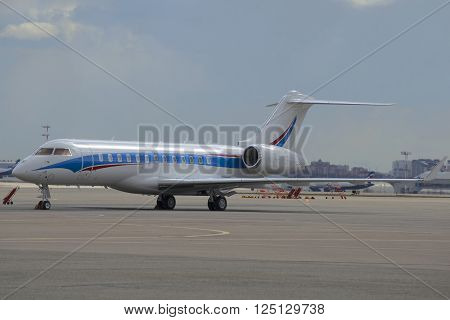MOSCOW, RUSSIA - APRIL 15, 2015: The Bombardier BD-700-1A10 Global 6000 (LX-NAD) at the airport Sheremetyevo