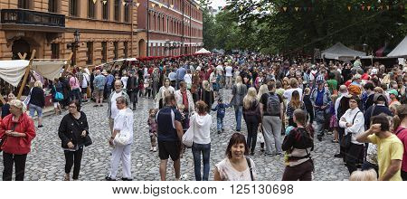 TURKU, ABO FINLAND ON JUNE 29. View of spectator, viewer, audience in a square on June 29, 2013 in Turku, Abo Finland. Unidentified people in the Medieval Festival. Stand along the walls. Editorial use.