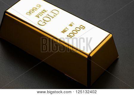 closeup of gold bullion on a dark background