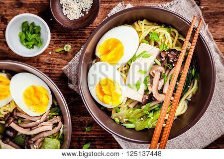Asian miso ramen noodles with eggs tofu and shimeji mushrooms