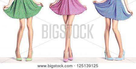 Woman long legs in fashion dress and high heels. Perfect female  sexy legs in stylish colorful skirt and summer glamour shoes, various playful poses. Unusual creative elegant walking out outfit, people