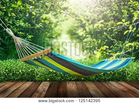 Relaxing on hammock in garden at summer